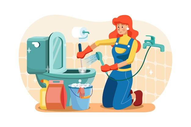 Encanadores estão absorvendo a água e limpando o banheiro.