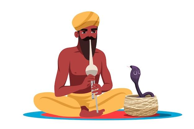 Encantador de serpentes indiano barbudo isolado no fundo branco. dança cobra cobra durante músico tocando flauta. treinador masculino usando turbante e calças tradicionais sentado em posição de lótus