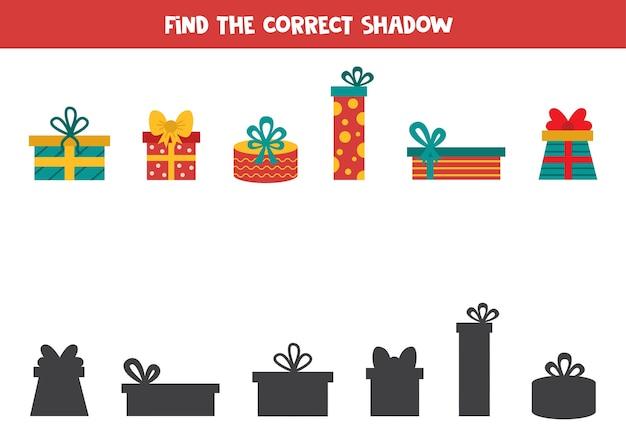 Encontre sombras de caixas de presentes de natal. jogo lógico educativo para crianças.