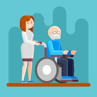 Enfermeira com velho deficiente em uma cadeira de rodas.