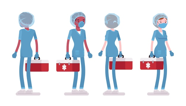 Enfermeira masculina e feminina em pé com caixa de ferramentas vermelha