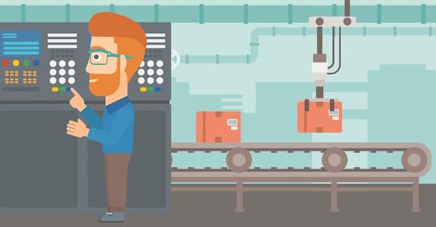 Engenheiro em pé perto do painel de controle.