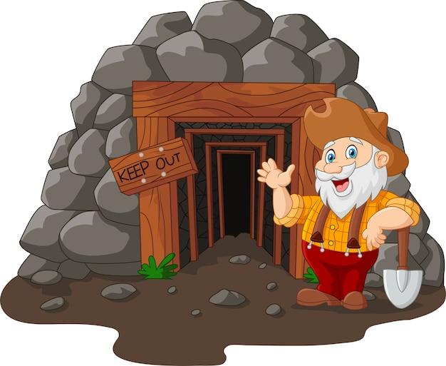 Entrada de mina dos desenhos animados com mineiro de ouro