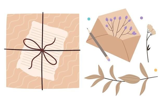 Envelope e presente com flores secas.