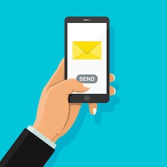 Envio de email pelo smartphone. o homem de negócios que guarda o telefone que toca sobre em envia o botão.