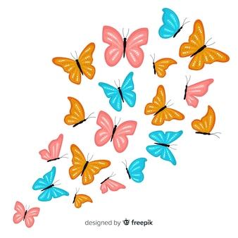 Enxame de borboleta voando fundo
