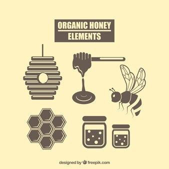 Equipamentos de mel orgânico do vintage no design plano