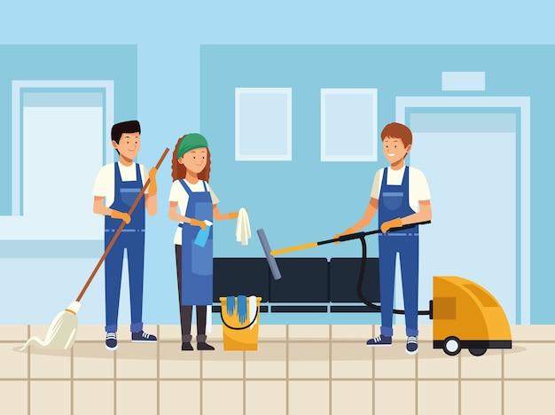 Equipe de limpeza com ferramentas de equipamento