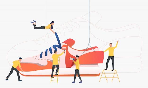 Equipe de trabalhadores produzindo tênis