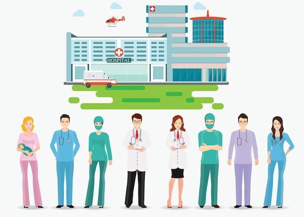 Equipe médica e hospital de construção