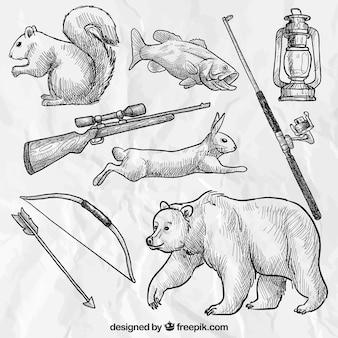 Esboçado animais da floresta e armas de caça