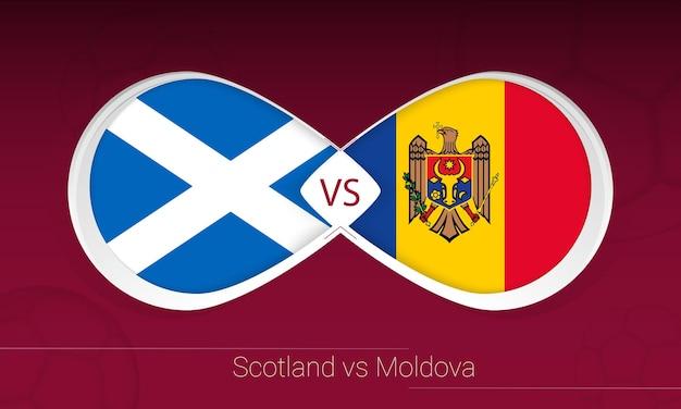 Escócia vs moldávia em competição de futebol, ícone do grupo f. versus no fundo do futebol.