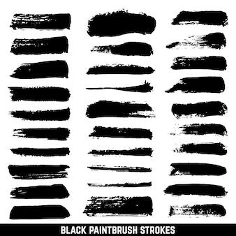 Escovas artísticas da gota da pintura da tinta do vetor. traçados escovados com tinta isolados. coleção de pinceladas sujas de preto. pincel de ilustração desenho traço de tinta