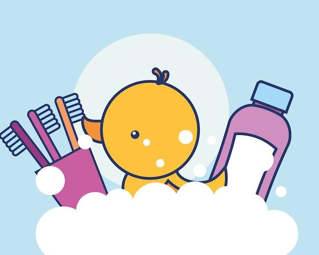 Escovas de dentes creme dental e bolhas de pato de borracha