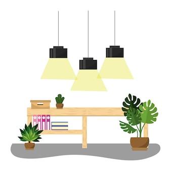 Escritório com lâmpadas penduradas e mesa com livros