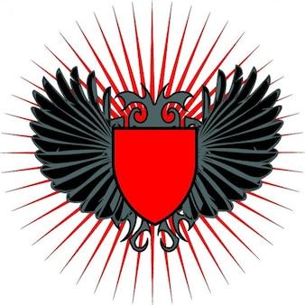 Escudo vermelho com asas negras