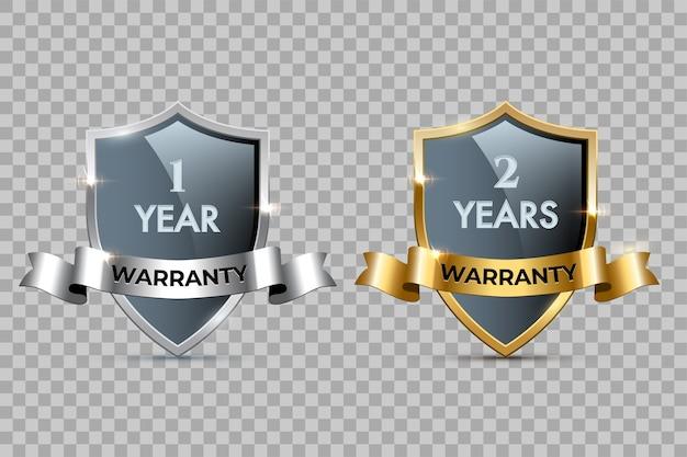Escudos de vidro com molduras douradas e prateadas e fitas com um ano de garantia e textos de dois anos de garantia.