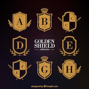 Escudos heráldicos dourados clássicos