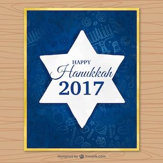 Escuro cartão azul com a estrela de hanukkah