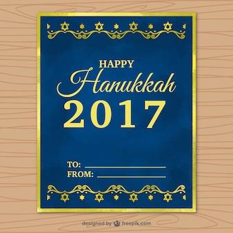 Escuro cartão azul de hanukkah com quadro dourado