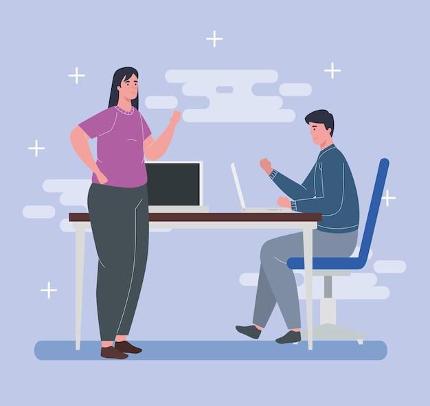 Espaço de coworking, jovem casal com laptops e mesa, conceito de trabalho em equipe.