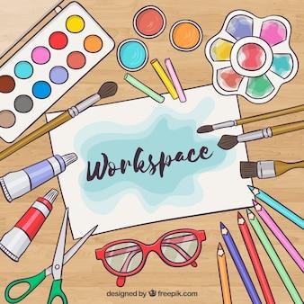 Espaço de trabalho criativo com elementos aquarela