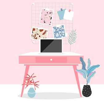 Espaço de trabalho em casa. interior do quarto rosa. trabalhar em casa durante o isolamento. laptop em cima da mesa. mesa de trabalho rosa, placa de memória na parede e plantas. vida moderna e design de interiores moderno.