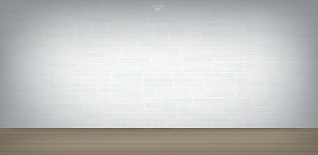 Espaço vazio com parede de tijolos brancos e piso de madeira
