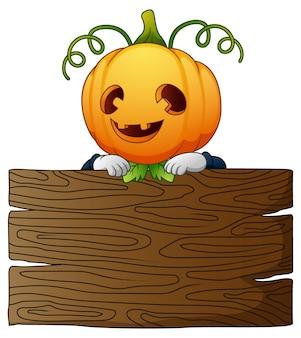 Espantalho de desenhos animados de halloween com placa de madeira