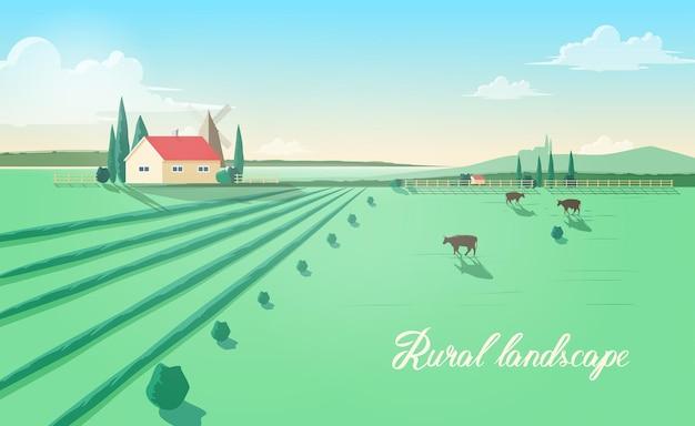 Espectacular paisagem rural com construção de fazenda, moinho de vento, vacas pastando em campo verde contra lindo céu no fundo.