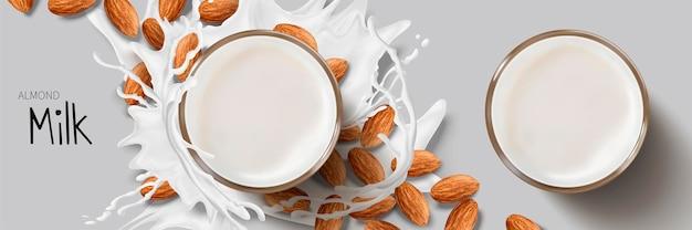 Espirrando leite em torno do copo de vidro e sementes de amêndoa