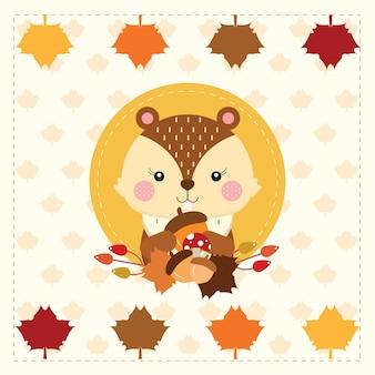 Esquilo fofo na grinalda de outono