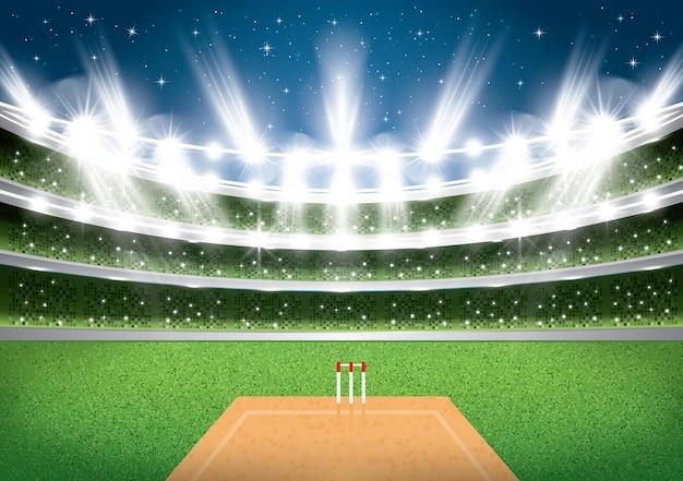 Estádio de críquete com holofotes.