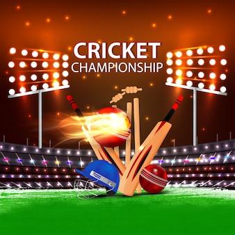 Estádio de esportes de críquete com bastão e bola no terreno.