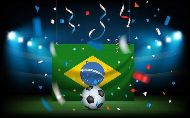 Estádio de futebol com a bola e bandeira do brasil