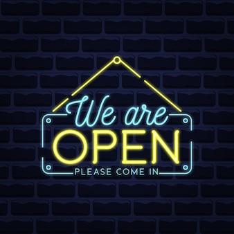 Estamos abertos, venha com luzes de neon azuis e amarelas