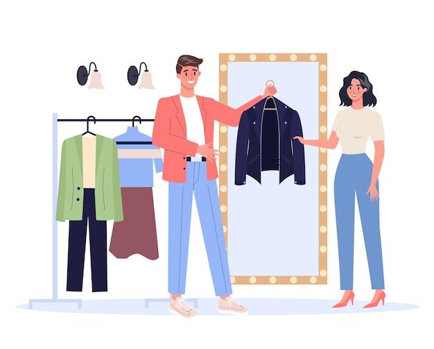Estilista de moda masculina jovem segurando uma jaqueta de couro para a mulher. trabalho moderno e criativo, personagem do homem escolhendo roupas.