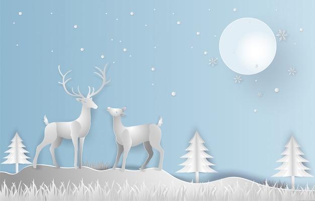 Estilo de arte de papel ilustração da temporada de inverno e bonita de renas com paisagem Vetor Premium