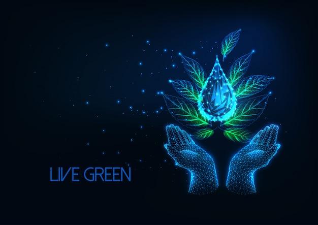 Estilo de vida futurista e ecológico com as mãos segurando as folhas verdes e a gota de água