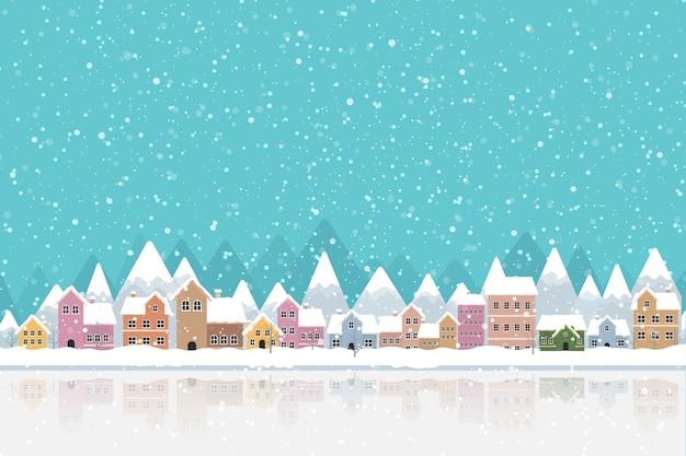 Estilo simples de cidade de inverno com neve caindo e montanha