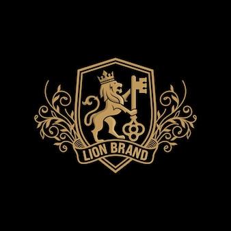 Estoque de design de luxo de logotipo chave lion isolado no preto