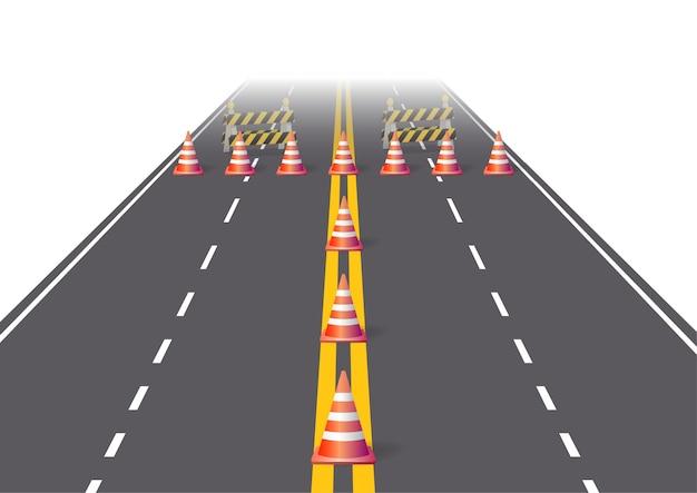 Estrada de asfalto com cones e placa de construção.