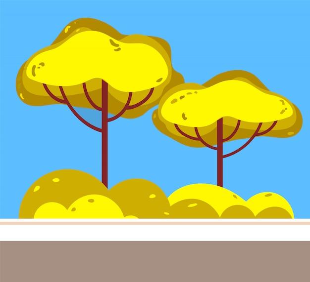 Estrada no parque, árvores verdes e bush crescendo atrás