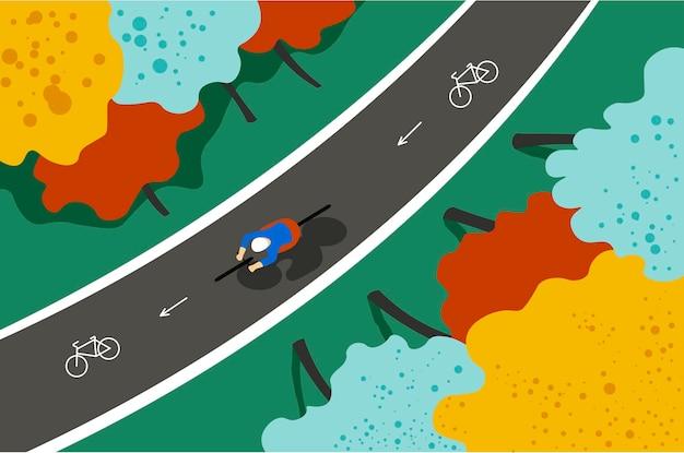 Estrada para bicicletas no topo da paisagem de outono do parque