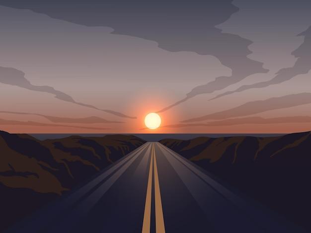 Estrada reta vazia ao pôr do sol