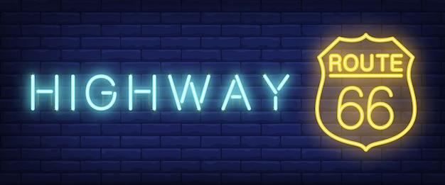 Estrada, rota sessenta e seis texto de néon no sinal de escudo