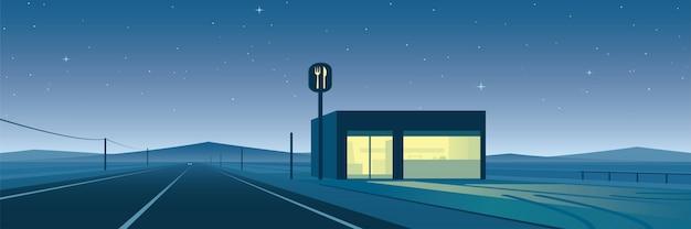 Estrada solitária e restaurante à noite
