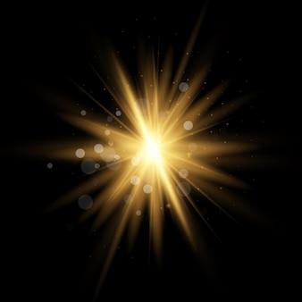 Estrela amarela dourada estourou com poeira e brilho isolado. efeito de luz brilhante com raios e partículas de brilho.
