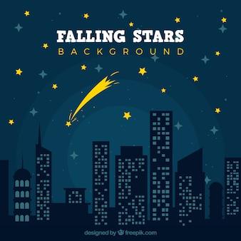 Estrela em queda numa cidade noturna