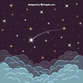 Estrela que cai acima das nuvens